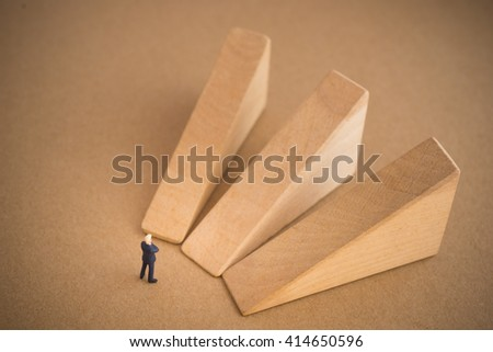 Businessman thinking or making decision in front of three option graph.  - stock photo