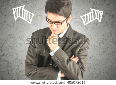 businessman thinking or making decision with left and right arrow - stock photo