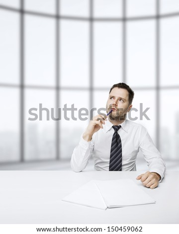 businessman thinking sitting at table in office