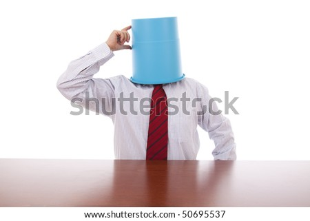 businessman thinking with a bucket on his head - stock photo