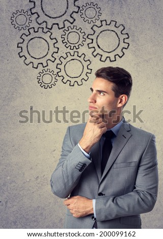 businessman thinking with a draw a gear system - stock photo