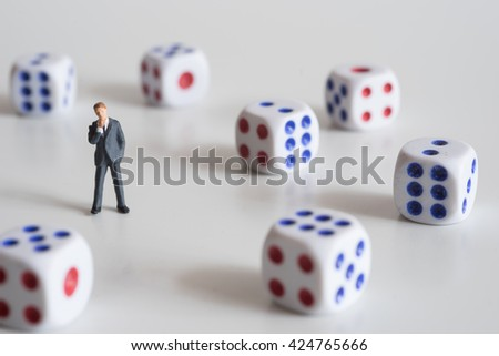 Businessman thinking with dice. Business risk concept. - stock photo