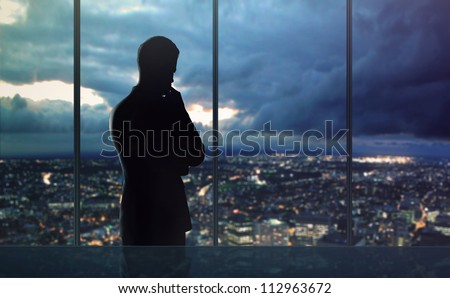 businessman thought and city nightlife - stock photo