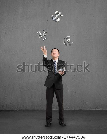 Businessman throwing and catching 3D sliver money symbols with concrete background - stock photo
