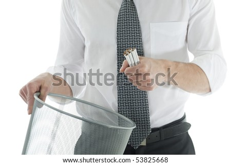 Businessman throwing cigarettes. Concept: give up smoking. - stock photo