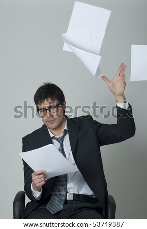 Businessman throwing documents away! - stock photo