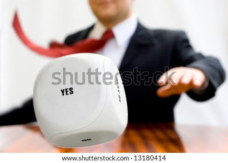 Businessman throwing the dice to make a decision - stock photo