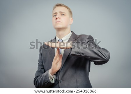 Businessman timeout gesture - stock photo