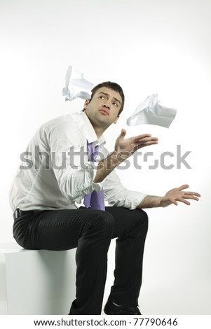 businessman tossing up crumpled papers in resignation - stock photo