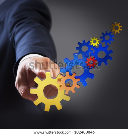 Businessman touch gear to success - stock photo