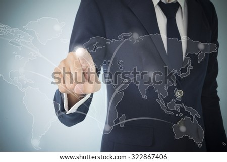 Businessman  touch screen technology network world - stock photo