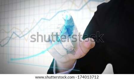 Businessman touch screen with chart