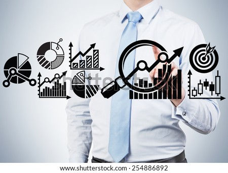 businessman touch search partner schem on gray background - stock photo