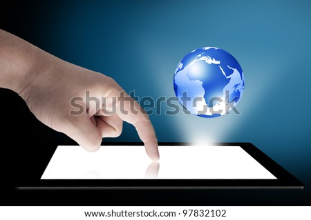 Businessman touch tablet PC screen with blue internet globe coming out from the screen. Concept for internet and connectivity - stock photo