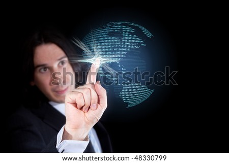 Businessman touching a world globe made of a binary code, isolated against a black background - stock photo
