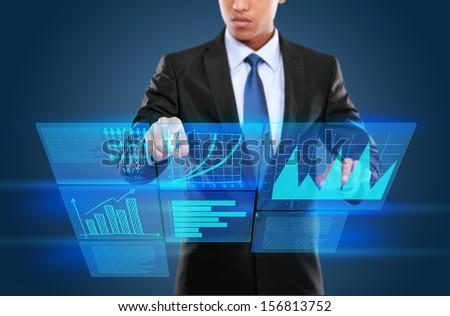 Businessman touching an icon on a touch screen monitor. conceptual image - stock photo