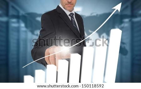 Businessman touching bar chart interface with world map on background in data center