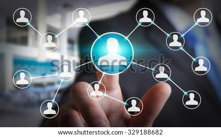 Businessman touching digital screen with social network connection