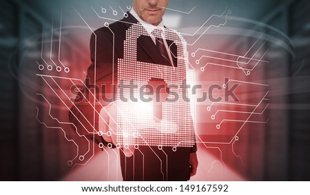 Businessman touching futuristic lock and circuit board interface in data center - stock photo
