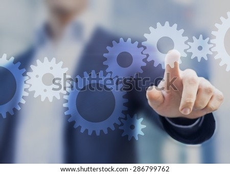 Businessman touching gears