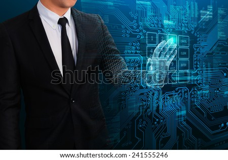 businessman touching glow electric circuit to access virtual network - stock photo