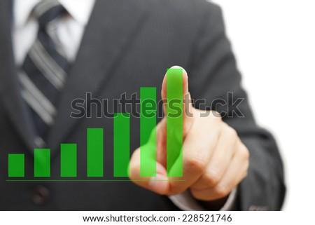 businessman touching growing virtual graph column. Positive trend concept - stock photo