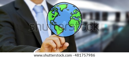 Businessman touching hand drawn planet earth in his hand