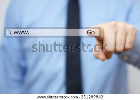 Businessman touching internet virtual search bar - stock photo