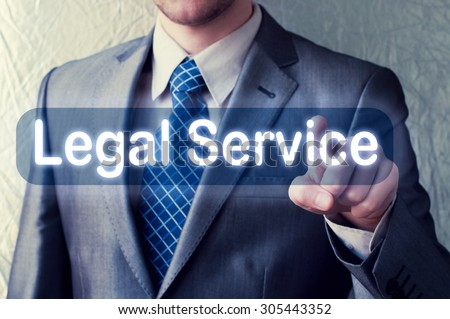 Businessman touching Legal Service button on virtual screen - stock photo