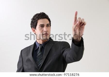 Businessman touching on a virtual screen - stock photo