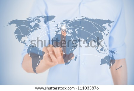 Businessman touching on world map with futuristic communication interface. - stock photo