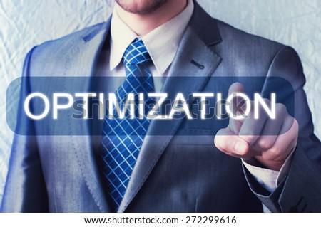 Businessman touching Optimization button on virtual screen - stock photo