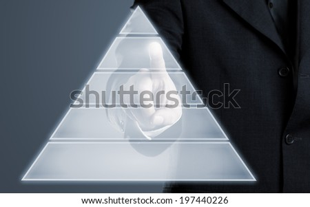 Businessman touching pyramid infogram graphics on virtual touchscreen with copy space - stock photo