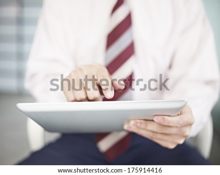 businessman touching screen of a tablet computer. - stock photo