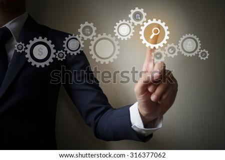 Businessman Touching Solution Gear on Success Concept , business ideas concept - stock photo