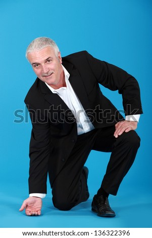 Businessman touching the floor