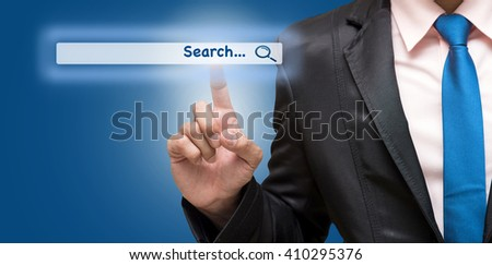 Businessman touching the virtual searching bar, Internet concept