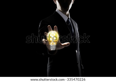 Businessman Touching Transparent Screen On Light Bulb - stock photo