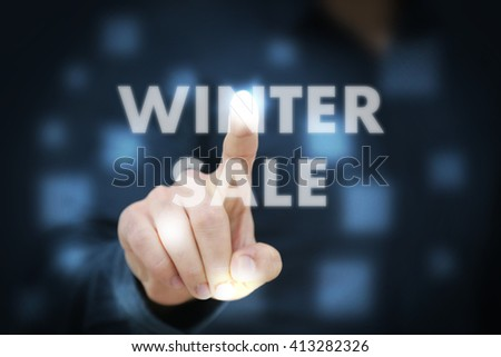 Businessman touching Winter Sale - stock photo