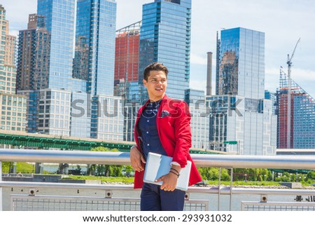 Businessman traveling, working in New York. Dressing in red blazer, blue collarless shirt, carrying laptop computer, a guy standing in busy business district, smiling, confidently looking forward.
