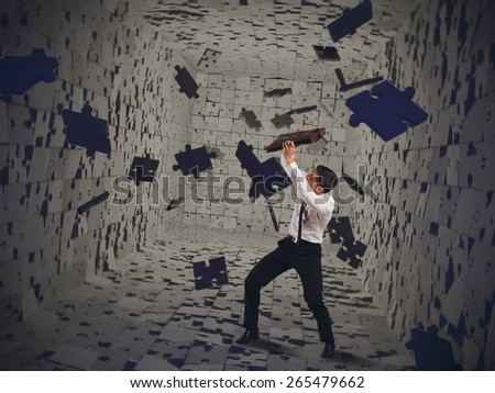 Businessman tries to repair himself from instability - stock photo