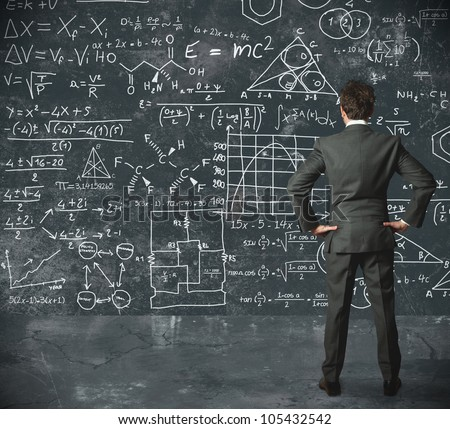 Businessman tries to solve problems - stock photo