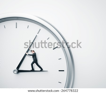 Businessman trying to stop time - stock photo
