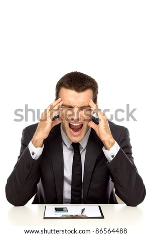 Businessman under stress - stock photo