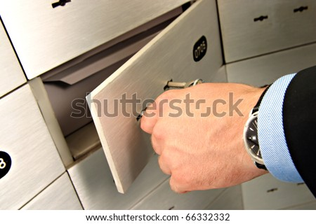 businessman unlocking safe