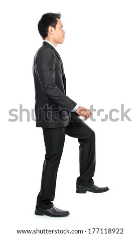 Businessman up the staircase over white background. ready for your design - stock photo