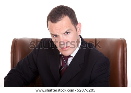 Businessman upset seated on a chair, isolated on white background. Studio shot. - stock photo