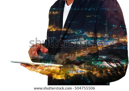 Businessman use Mobile phone with City and Communication Antenna Tower at Night, Double Exposure as Wireless Telecommunication Technology concept.