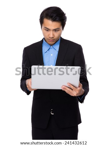 Businessman use of the laptop computer - stock photo
