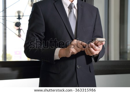 Businessman use smartphone device in the work